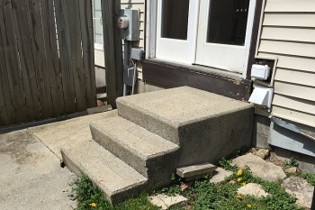Stooping concrete porch